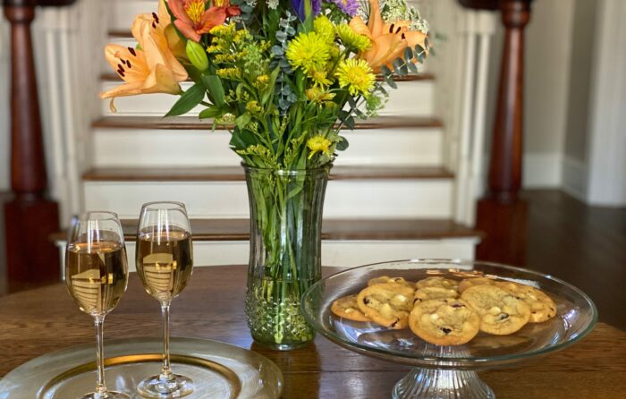 cookies and champagne to welcome guests to sweet biscuit inn